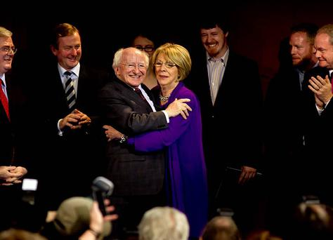 President of Ireland Michael D Higgins and his wife Sabina celebrate at Dublin Castle Count Centre yesterday with his Daughter Alice Mary, sons Michael and John, also included are Taoiseach Enda Kenny and Tainiste Eamon Gilmore and (on right) Martin McGuinness. Photo:Mark Condren