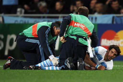 DUNEDIN, NEW ZEALAND - SEPTEMBER 10: Gonzalo Tiesi of Argentina lies on the ground injured during the IRB 2011 Rugby World Cup Pool B match between Argentina and England at Otago Stadium on September 10, 2011 in Dunedin, New Zealand. (Photo by Warren Little/Getty Images)