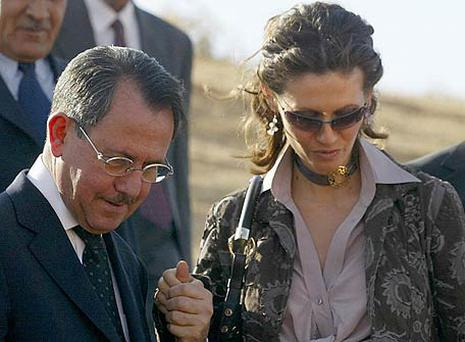 Syria's First Lady Asma al-Assad holds her father Fawaz al-Akhras' hand as she tours the historic Syrian city of Ebla in 2004