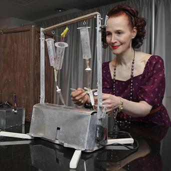Ava Janus the sole surviving heir of Dr Jack Kevorkian, poses with his Thanatron machine (AP)