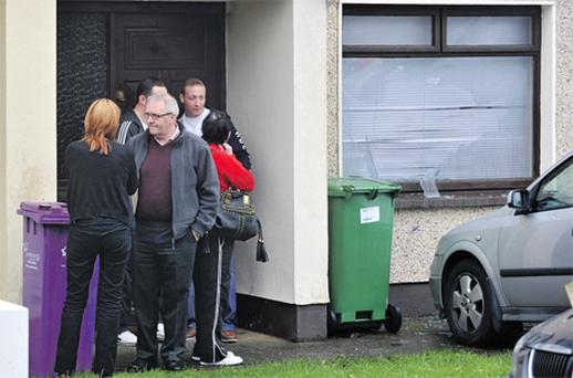 Family of Stacey Ellard with a neighbour at the scene of the fatal fire in Wilton, Cork, yesterday