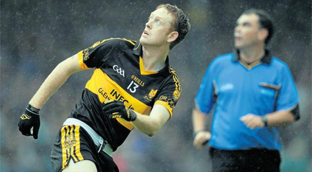 Dr Crokes' Colm Cooper, and referee Paul Hayes, watch his point attempt go over the bar during yesterday's Kerry SFC final