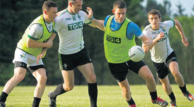 Ireland players (l-r) Leighton Glynn, Steven McDonnell, Stephen Cluxton and Colm Begley in action at training on Australia's Gold Coast