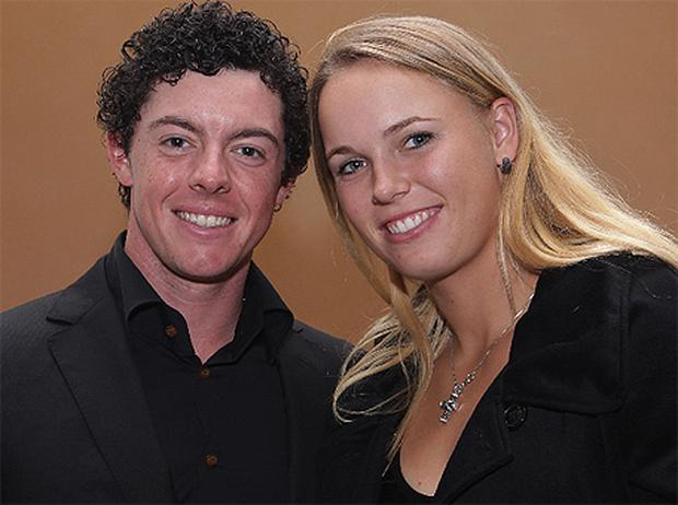 Golfing hero Rory McIlroy and girlfriend Caroline Wozniacki in Shanghai yesterday