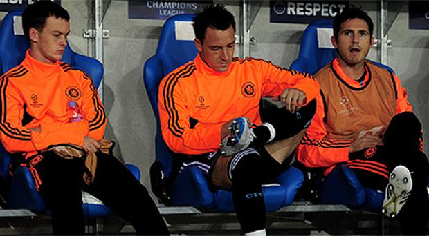 Chelsea fans were heard chanting 'Anton Ferdinand you know what you are' in relation to the racism row involving captain John Terry, centre, who was a substitute last night