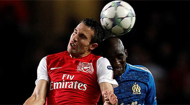 Robin van Persie and Marseille's Rod Fanni, right, challenge for the ball