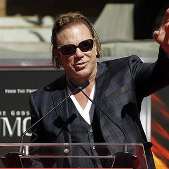 Mickey Rourke paid tribute to his late grandmother as he was honoured in Hollywood