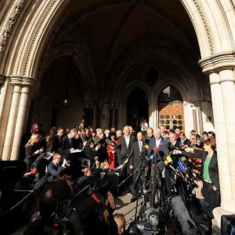 Wikileaks founder Julian Assange speaks to the media outside the Royal Courts of Justice