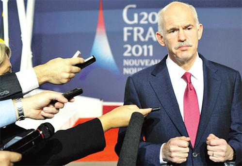 Greek Prime Minister George Papandreou answers questions at his news conference