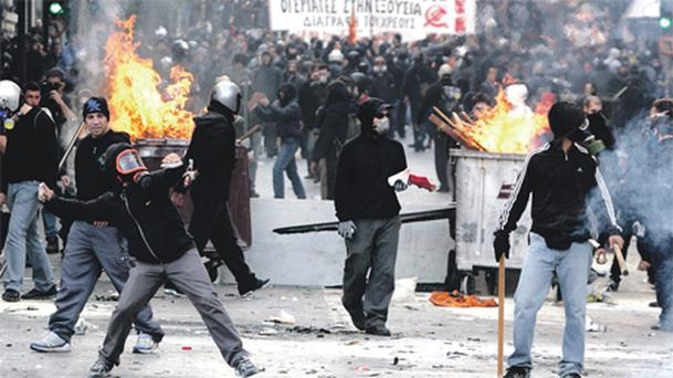Demonstrators take to the streets against cuts in Greece