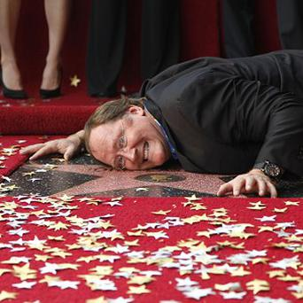 Pixar's John Lasseter was honoured with a star on the Hollywood Walk of Fame