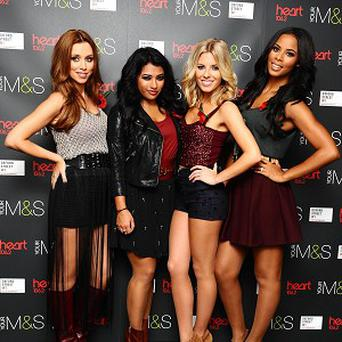 The Saturdays, minus Frankie Sandford, switched on the Oxford Street Christmas lights in London