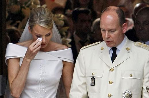 SALT: Charlene Princess of Monaco wipes away tears as she leaves the church after marying Prince Albert II of Monaco