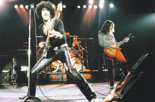 Phil Lynott on stage with Thin Lizzy