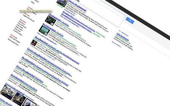 Google web page spins if you type in ' Do a Barrel Roll'