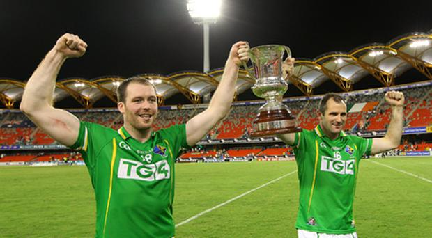 Ciaran McKeever (L) and Steve McDonnell of Ireland celebrate winning the Cormac McAnallen Perpectual Trophy in the International Rules match between Australia and Ireland. Photo: Getty Images