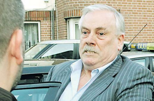 Developer Tom McFeely refuses to accept an envelope believed to contain a summons outside the High Court yesterday.