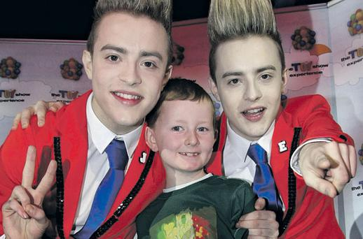 Jedward with Will Humphreys, from Donabate, Co Dublin, at the Toy Show Experience in the Convention Centre yesterday