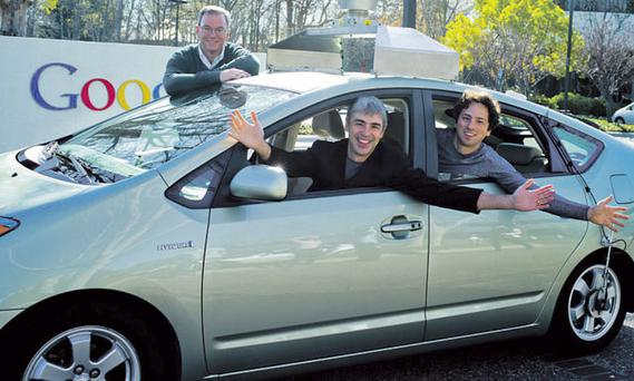 Wheels of fortune: (L-R) Google Executive Chairman Eric Schmidt; CEO Larry Page; and cofounder Sergey Brin in Google's new self-driving car.