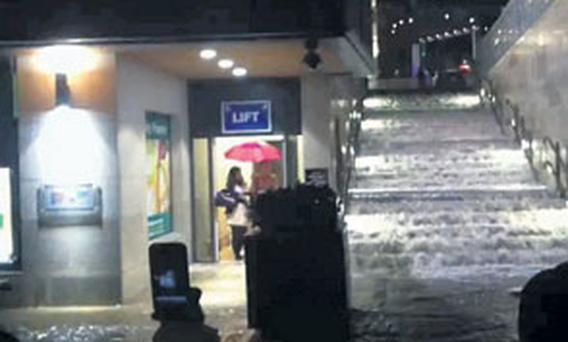 SOFT DAY: Water cascades down into Dundrum Town Centre