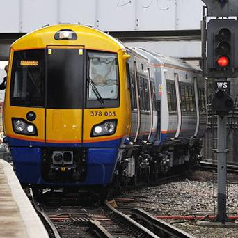 A man has hired a choir to help him propose to his girlfriend on a London Overground train