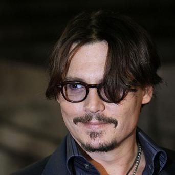 Johnny Depp arrives for the European premiere of The Rum Diary at Odeon Kensington in west London