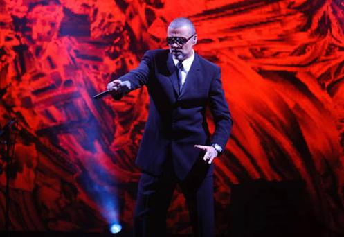 George Michael performing on stage at the Royal Opera House in Covent Garden, London, in aid of the Elton John Aids Foundation