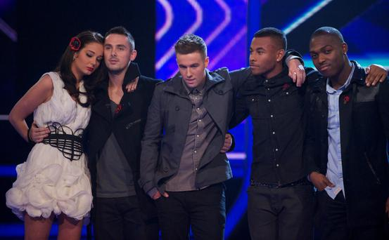 The X Factor Results Show Live on ITV1, Series 8, Fountain Studios, London, Britain - 6th November 2011. ------------------------------------The Boys:Marcus CollinsFrankie CocozzaCraig Colton------------------------------------The Girls:Janet DevlinMisha B------------------------------------Overs:Kitty BrucknellJohnny Robinson------------------------------------Groups:Little Mix - Jade, Jesy, Perrie, Leigh Ann-----------------------------------The Judges are as follows:Gary BarlowTulisa ContostavlosKelly RowlandLouis WalshThe Show is Presented by Dermot O'Leary