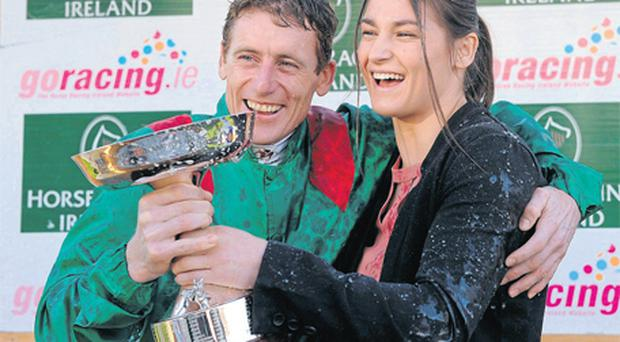 Johnny Murtagh receives his 2011 Champion Flat Jockey Trophy from World and European boxing champion Katie Taylor