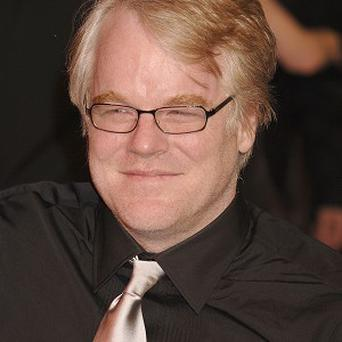 Philip Seymour Hoffman says being a director and actor on a film is tough