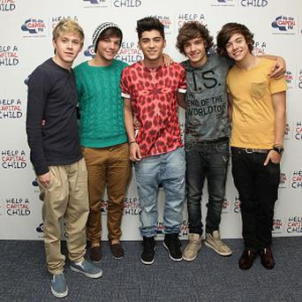Boy band One Direction have topped the calendar sales charts