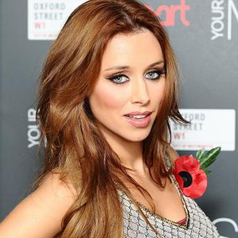 Pregnant star Una Healy of The Saturdays has vowed she will carry on touring