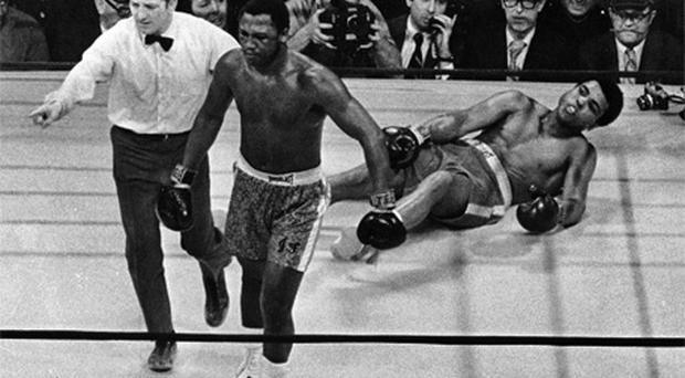 Joe Frazier being directed to the ropes by referee Arthur Marcante after knocking down Muhammad Ali during the 15th round of the 1971 title bout at Madison Square Garden in New York