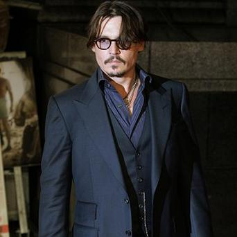 Johnny Depp says it's not important to him that The Rum Diary is a box office hit