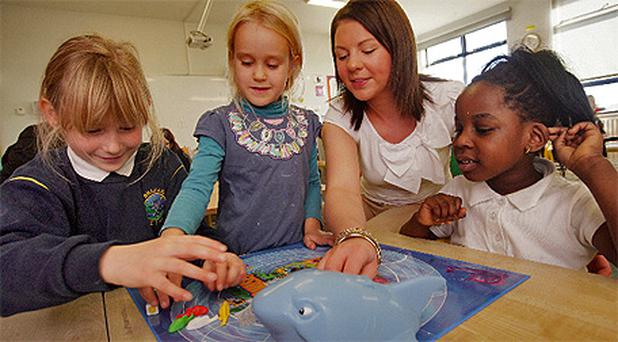 Life lessons: Teacher Aisling McQuaid plays Shark Chase with Monika Plutureviciute, Harmony Lawal and Karina Haczkienicz at Bracken Educate Together, Balbriggan
