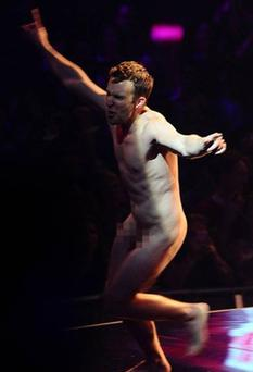 A streaker appears onstage as Hayden Panettiere is presenting at the MTV Europe Music Awards 2011 at the Odyssey Arena in Belfast