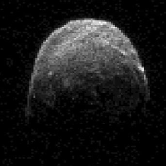 Asteroid 2005 YU55's closest approach to Earth was at a distance of 202,000 miles (Nasa/AP)