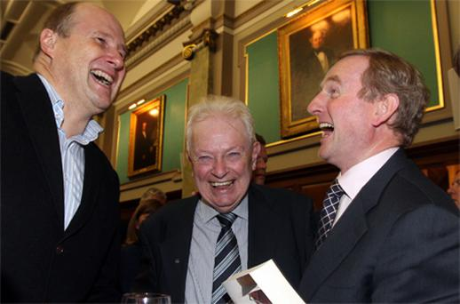 Taoiseach Enda Kenny with Ivan Yates (far left) and Peter Prendergast at the launch of 'Just Garret', Garret FitzGerald's updated autobiography, in Dublin last night
