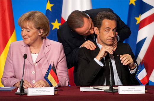 Angela Merkel, Silvio Berlusconi and Nikolas Sarkozy at a press conference in the early days of the crisis