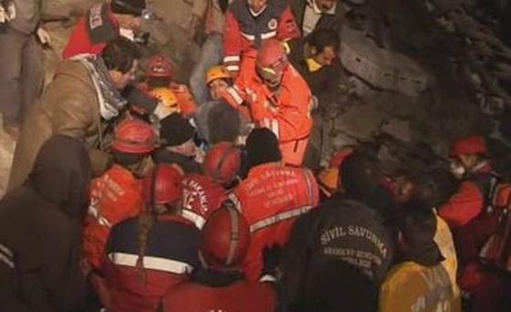 Rescuers assist earthquake survivor after a magnitude 5.7 earthquake struck 16 km (9 miles) south of the city of Van.