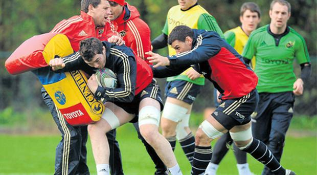 Munster's Peter O'Mahony in action against backs coach Jason Holland, Conor Murray, Niall Ronan and Denis Leamy during training at Cork Institute of Technology yesterday