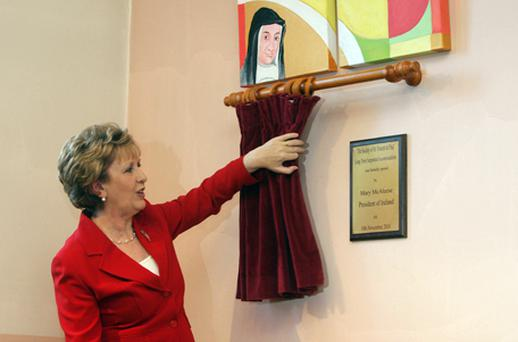 Mary McAleese unveils a plaque during the visit. Photo: PA