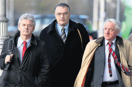 Ian Bailey, centre, arriving at court yesterday with his legal team Frank Buttimer, left, and Jim Duggan