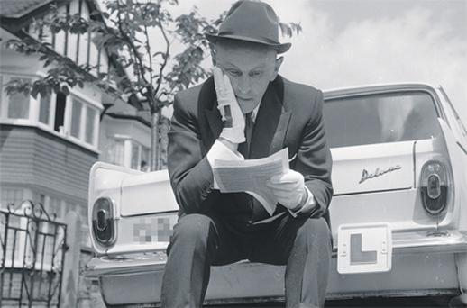A learner driver from the 1960s laments his bad luck again as he reads the results of his latest driving test