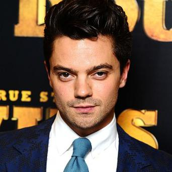 Dominic Cooper plays a reporter in the film