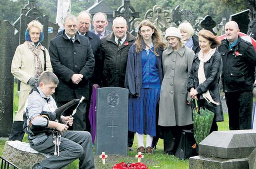 Oran O'Brien plays the Uileann pipes at the annual Armistice Day commemoration at Glasnevin Cemetery in Dublin