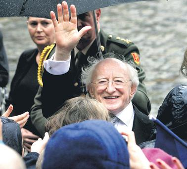 President Michael D Higgins greets schoolchildren from across the country during his inauguration at Dublin Castle yesterday.