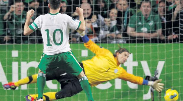Robbie Keane watches his penalty cross the line for Ireland's fourth goal on Friday night