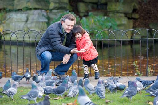 Jim Gray and daughter Sophia (2) enjoy the weather in St Stephen's Green in Dublin yesterday