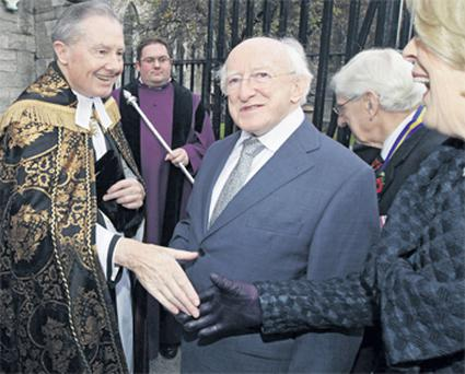 President Michael D Higgins is greeted by the Dean of St Patrick's Cathedral Rev Robert MacCarthy for the Remembrance Day service yesterday